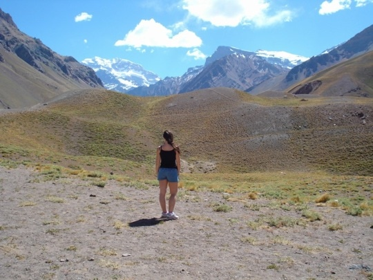 Girl looks at the mountains in Mendoza Argentina