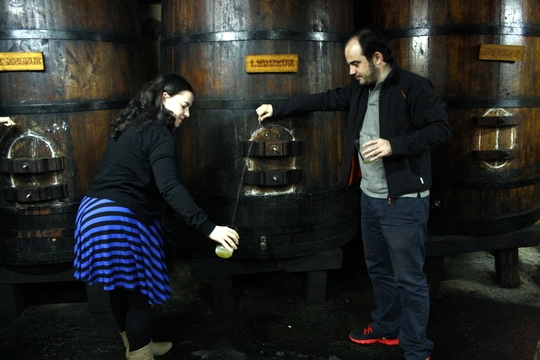 Pouring cider at the cider house