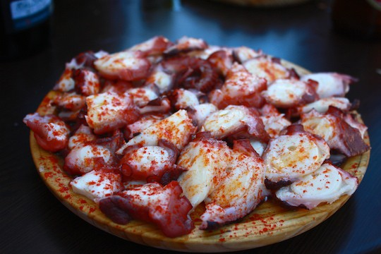 Finishing off a disc of octopus at a Galician fair is one of the food experiences in Spain that are on my bucket list