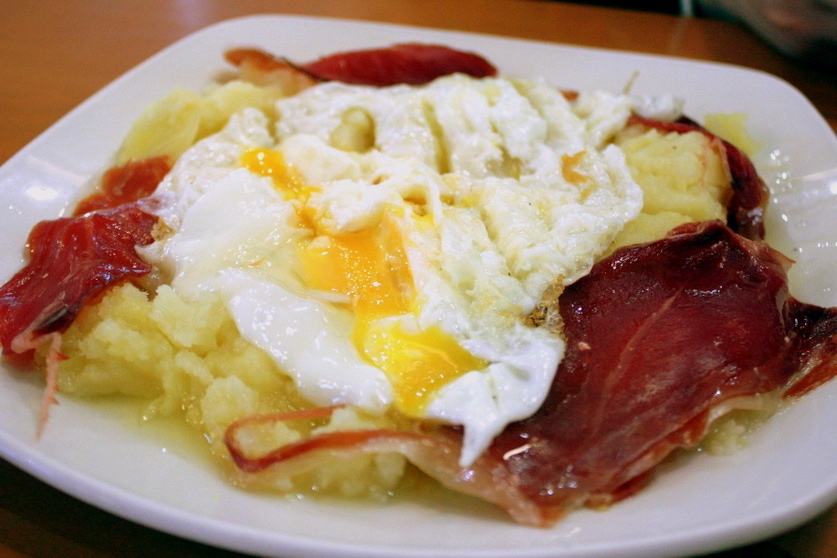 Huevos rotos at one of the best tapas bars in Madrid.