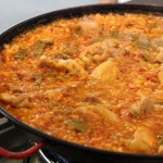 Taking a cooking class in Seville and making a paella.