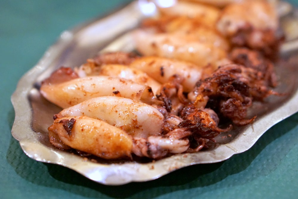 Asturias has amazing seafood-- here are some delicious grilled squid at a cider house in Ribadesella.