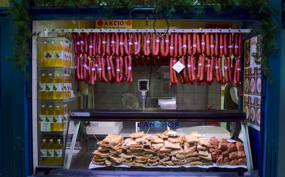 Sausage and lard at a stall in the Central Market Hall during a Budapest food tour.