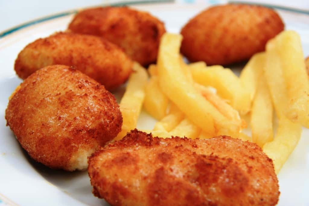 Ham croquettes on a plate with french fried