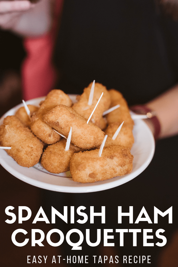 As far as tapas go, practically nothing is more typical than a plate of creamy, delicious croquettes. If you don't know how to make them, they do require time and patience, but are actually pretty easy! This recipe for traditional ham croquettes is straight from Spain, so you can rest assured that it's as authentic as it gets. Get ready to discover one of your new favorite dishes! #tapas #Spain