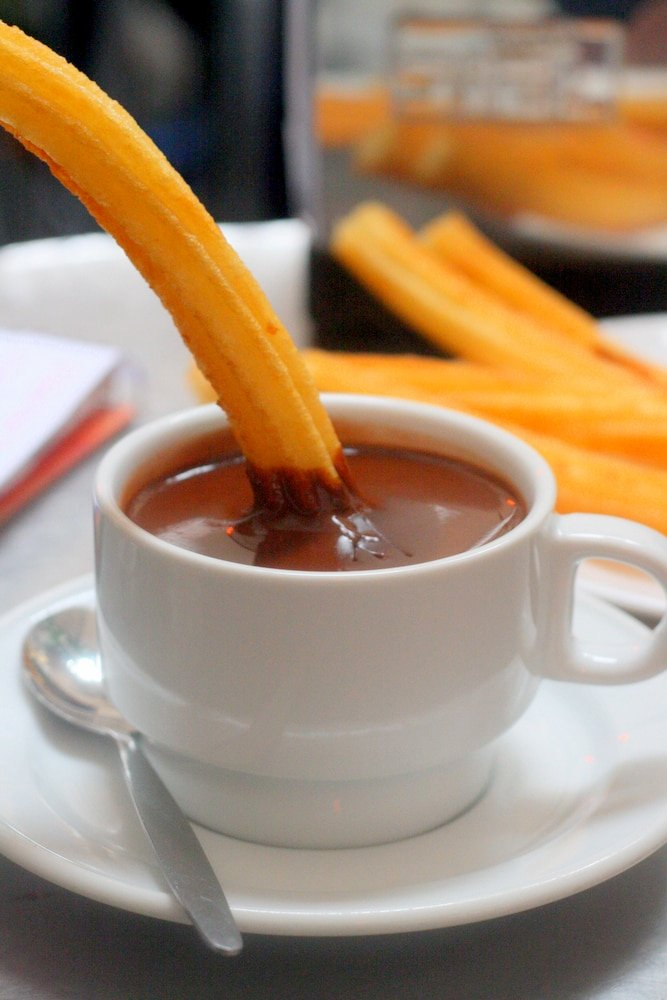 What to do in Madrid: Try churros con chocolate at Chocolateria San Gines.