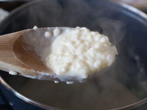 Arroz con leche in a wooden spoon
