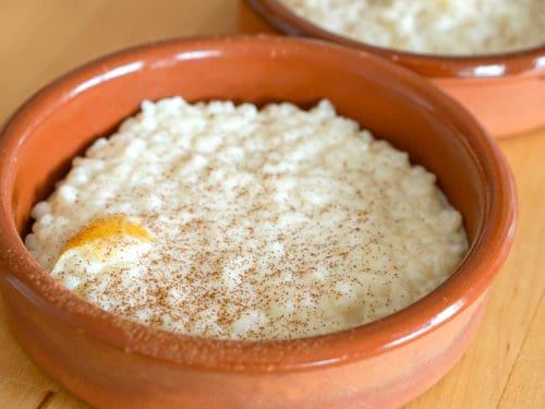 Homemade arroz con leche in a clay dish