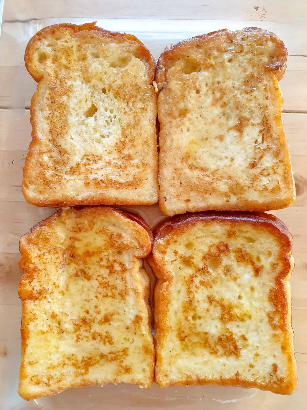 Four honey soaked torrijas made with sandwich bread.