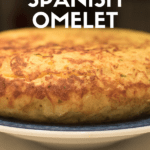 """Pinterest image for Spanish tortilla recipe. Photo of a Spanish omelette with text overlay reading """"The Perfect Spanish Omelet"""""""