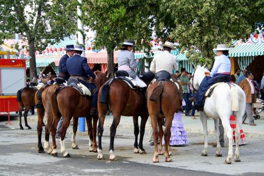 Chatting on horseback Feria Sevilla