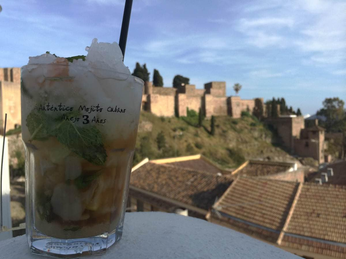 Enjoying a Mojito on the rooftop terrace in Malaga in May
