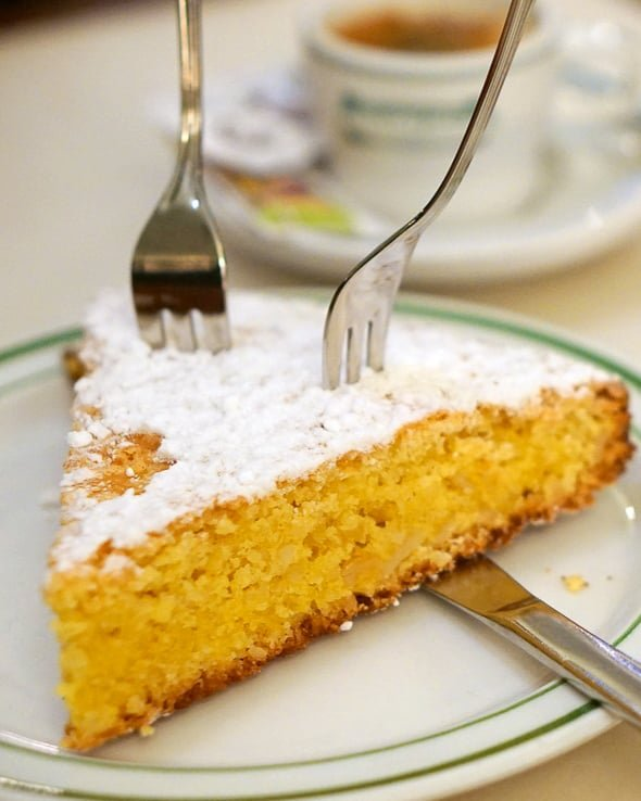 Tarta de Santiago on a plate with two forks.