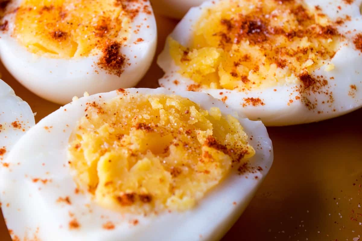 Close up of three deviled eggs sprinkled with paprika