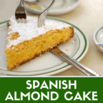 Spanish almond cake pinterest image of a piece of tarta de santiago with two forks.