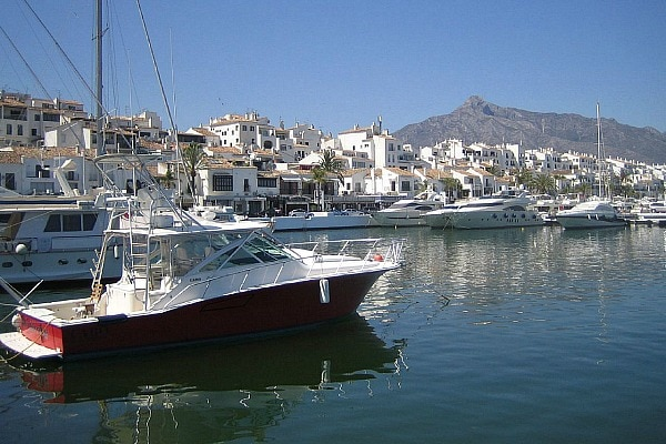 Visit the fancy harbor of Marbelle not far from Malaga in August!