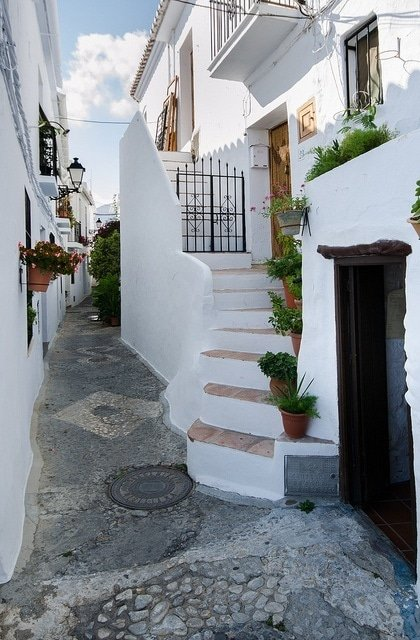 One of the white villages in Malaga that we love to visit for a day trip from Malaga. The winding streets are so charming and you can try the delicious miel de caña with eggplant!