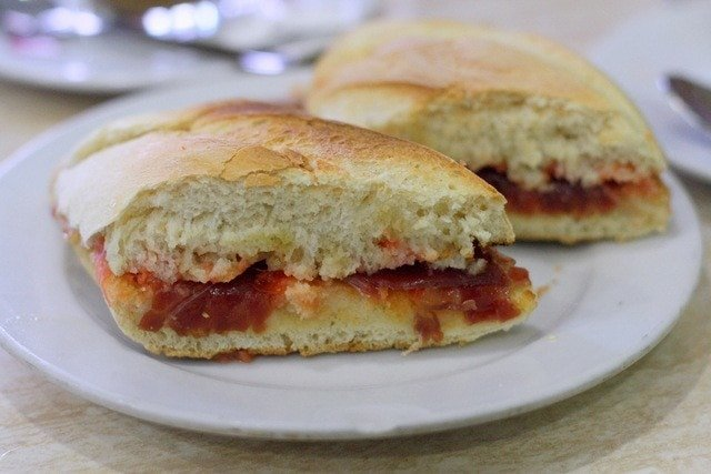 """The """"pitufo"""" is one of Malaga's most famous sandwiches. It's on the 100 things to do in Malaga because it is our favorite breakfast ever!"""