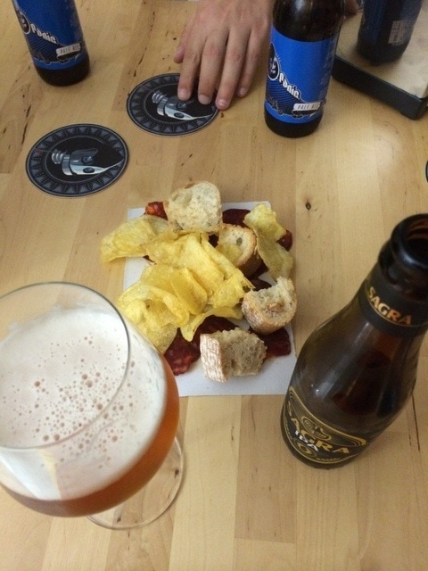 One of the places to drink craft beer in Malaga in the neighborhood of SoHo is the Rincon del Cervecero. We love that they brought us chips and chorizo! with our drinks!