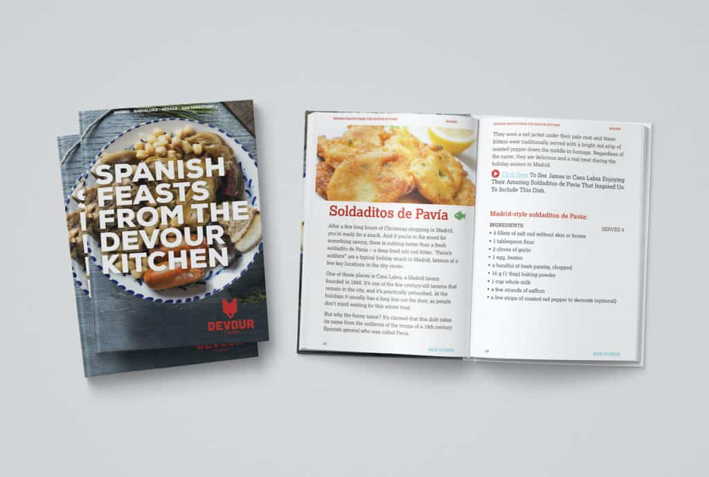 """Front of a cookbook titled """"Spanish Feasts from the Devour Tours Kitchen"""" with a second copy open to a recipe page."""