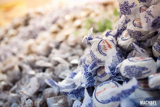 Manetcados and polvorones wrapped in wax paper at a Christmas market in Malaga
