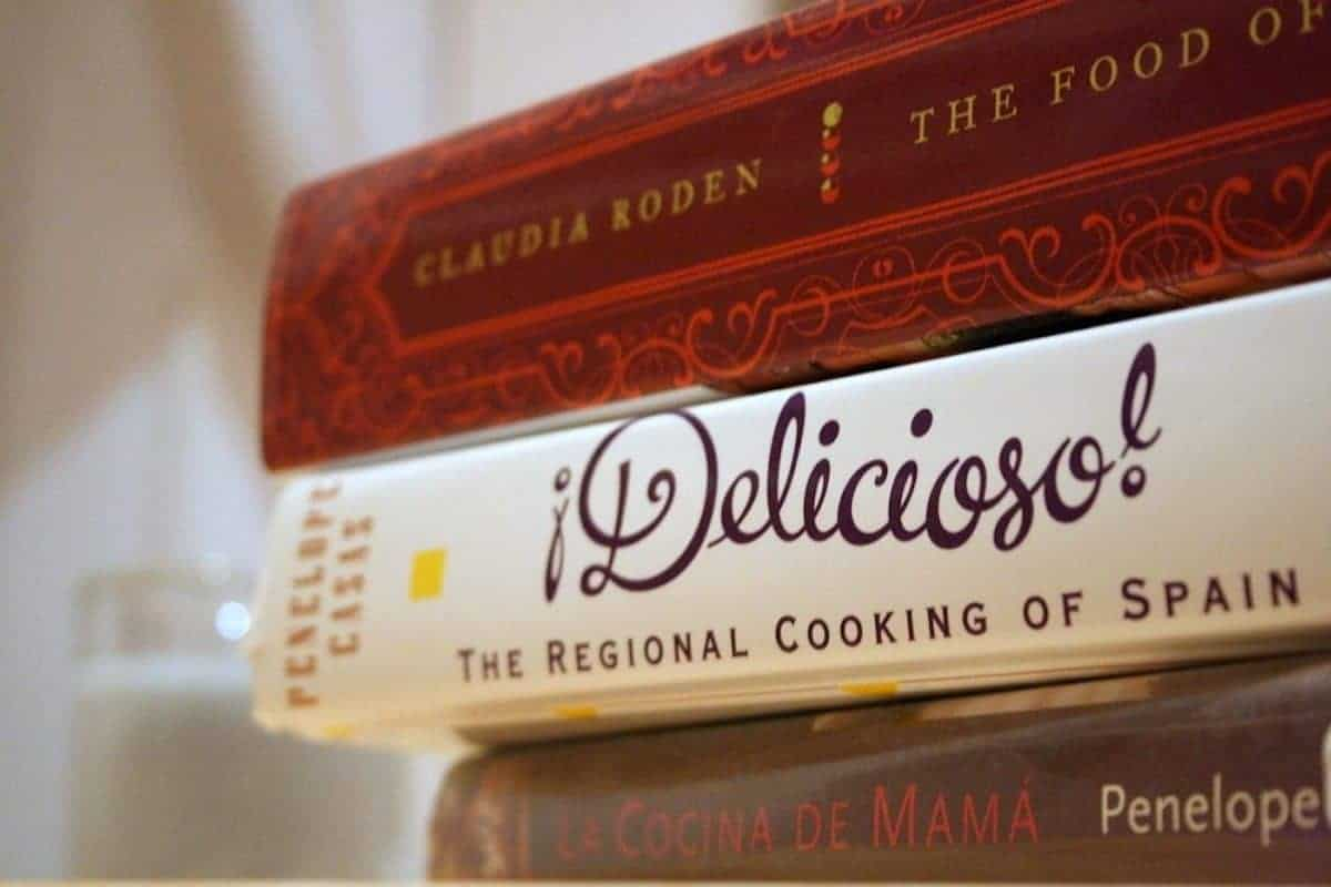 Close up of a stack of three Spanish cookbooks.