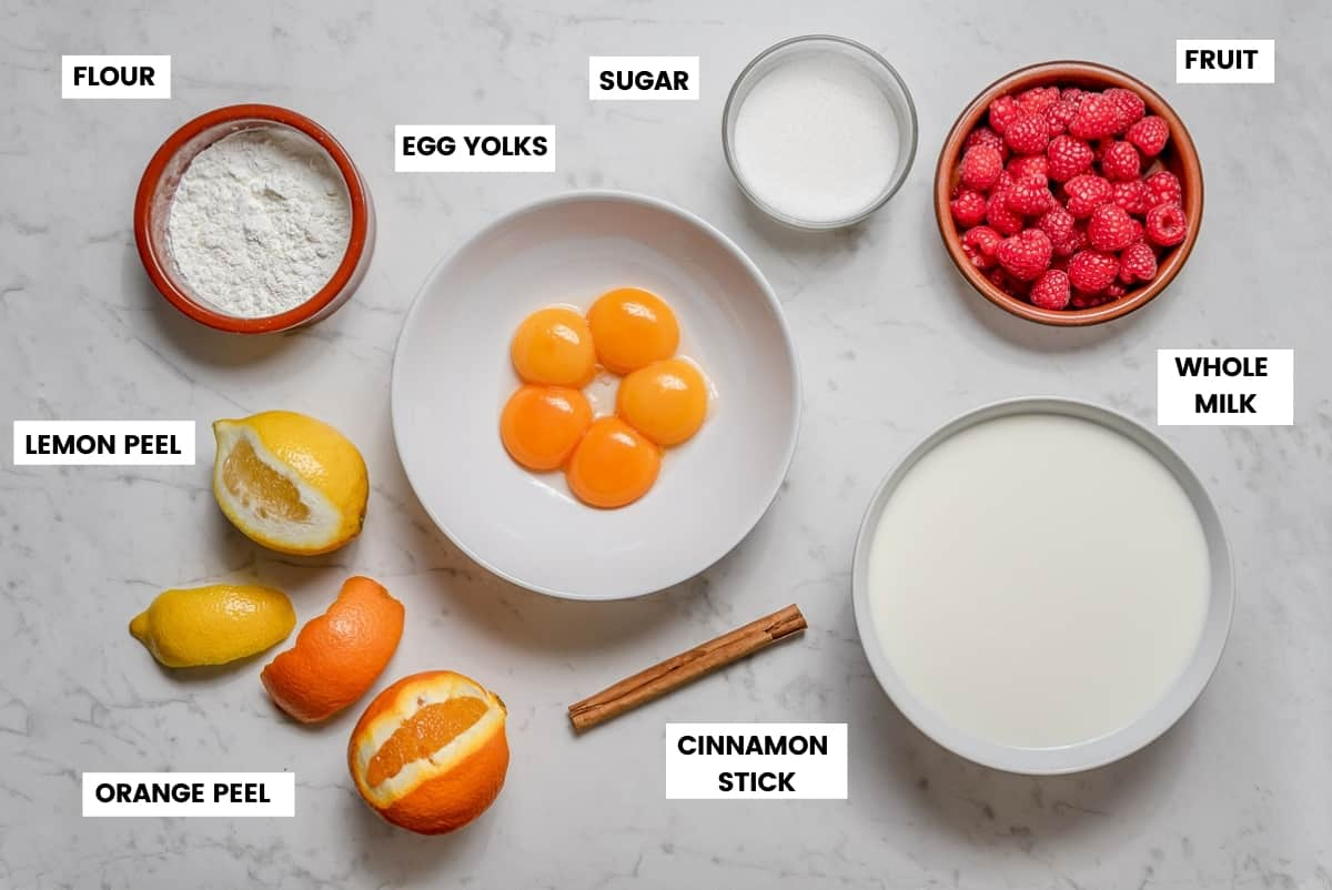 Crema Catalana ingredients on a white marble countertop