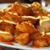 A plate of patatas bravas with sauce