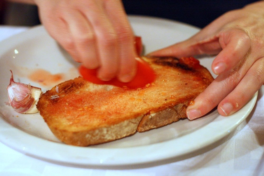 Tomato bread in Barcelona-- one of the most typical Barcelona tapas!