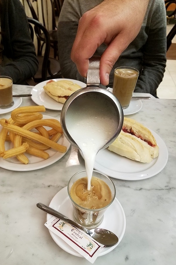 """If you are wondering where to eat in Malaga, don't miss breakfast at Cafe Central - churros, """"pitufo"""" and coffee - what more do you need?"""