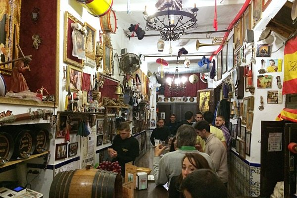 Las Merchanas, one of the best historic bars in Malaga, features a unique theme: they celebrate Holy Week all year long!