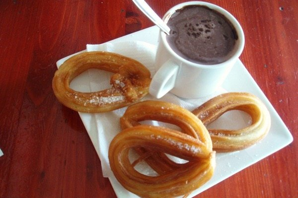 How to eat like a local in Malaga? Eat crispy churros with fresh chocolate dip!