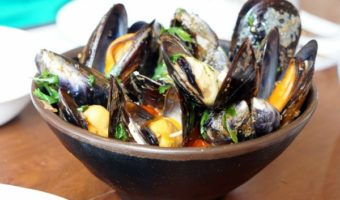A delicious typical food in Galicia are the regional mussels. They are delicious steamed with a squeeze of lemon over the top!