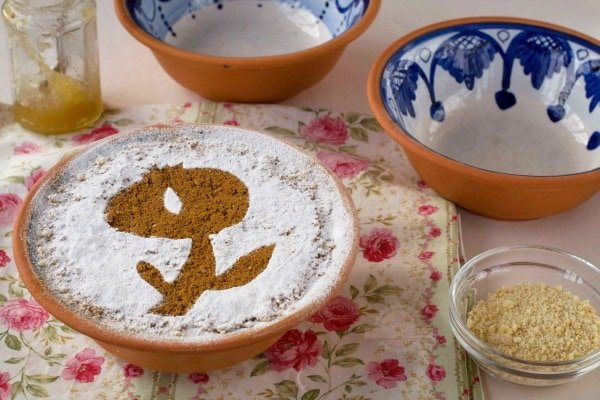 Cuajada de Carnaval is a dessert that's included in our list of the best typical food in Granada. This cake is made from leftover mantecados from Christmastime and it is a delicious treat.