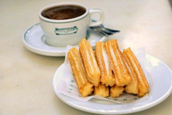 Churros sprinkled with sugar and rich hot chocolate, a traditional Spanish combination. Don't leave Galicia without trying the best churros and chocolate in Santiago de Compostela!