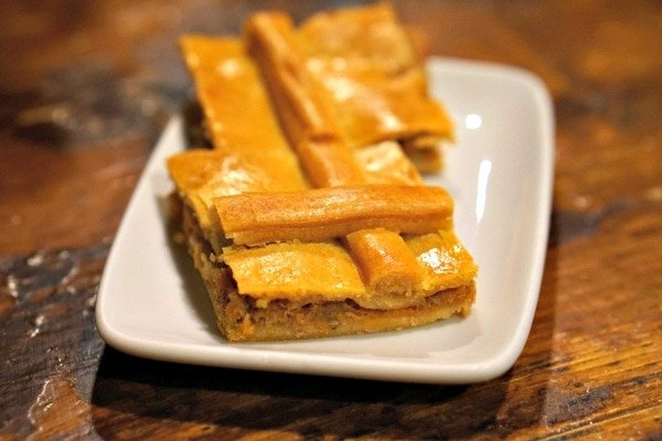 Crispy and delicious Galician empanada, a favorite dish to order at tapas bars in Santiago de Compostela.