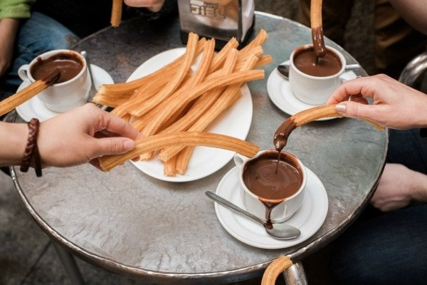 Hot chocolate and churros, part of a complete breakfast! Try some artisanal chocolate and a variety of other traditional Spanish treats on our Insider's Tapas & Wine Evening Tour in Santiago!