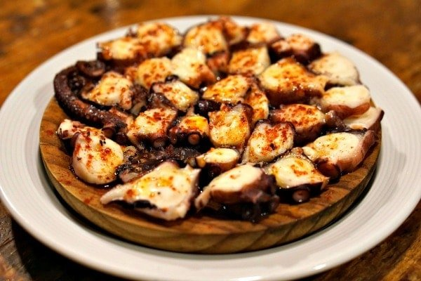 One of the must-try dishes at tapas bars in Santiago de Compostela is boiled octopus topped with paprika!