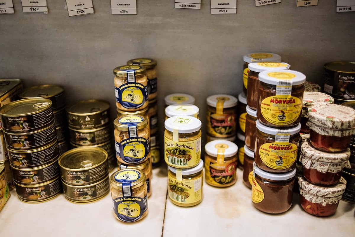 Selection of Spanish canned seafood and other jarred products on a shelf