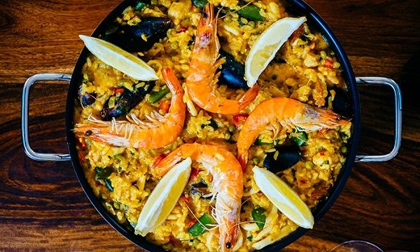 Las Perdices is one of the best places to eat paella in Granada. Great options are arroz caldoso, paella mixta, or the seafood paella seen here.