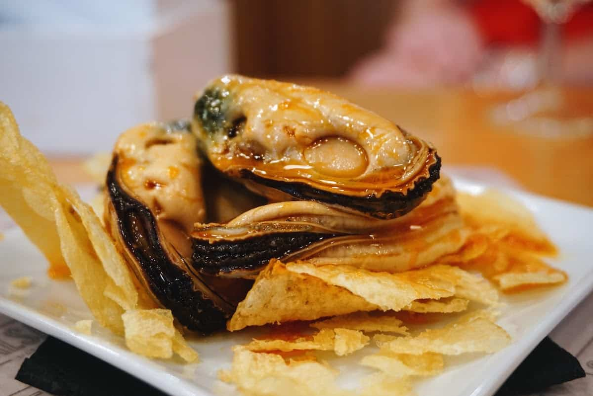 Canned mussels served over potato chips