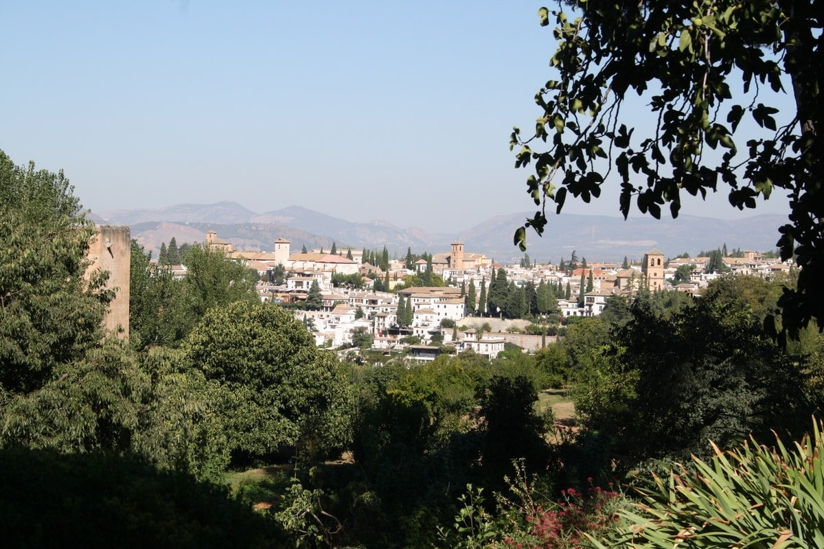 When searching for where to stay in Granada, take into account the amazing views you could get from your room if you choose the right hotel, like this view over the white houses of the city