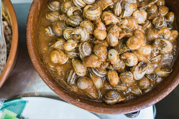 Try caracoles (snails) at Los Mascarones in Granada, one of the best places to eat in the Albayzín.