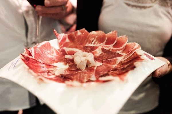 Enjoying a plate of jamón ibérico is one of the most classic things to do in Granada for foodies.