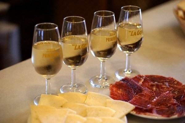 Stop by Contreras Selectos, one of the best wine shops in Granada, for delicious jamón and cheese as well as vino!