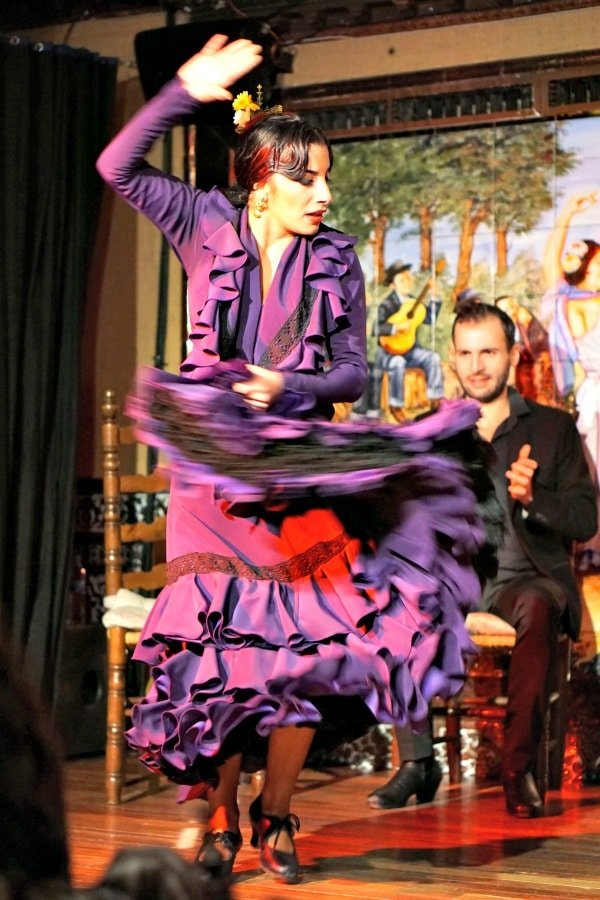 Head to a flamenco show in Granada when it's raining! You'll stay dry and experience an integral part of Andalusian culture.
