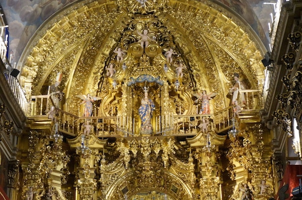 7 days in Granada won't be complete without marveling at the stunning golden interior at the St. John of God Basilica.