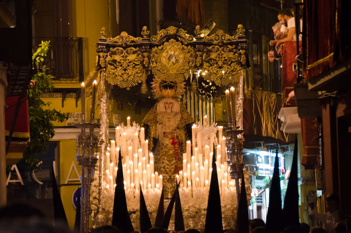 Holy Week float covered in candles and a statue of the Virgin Mary