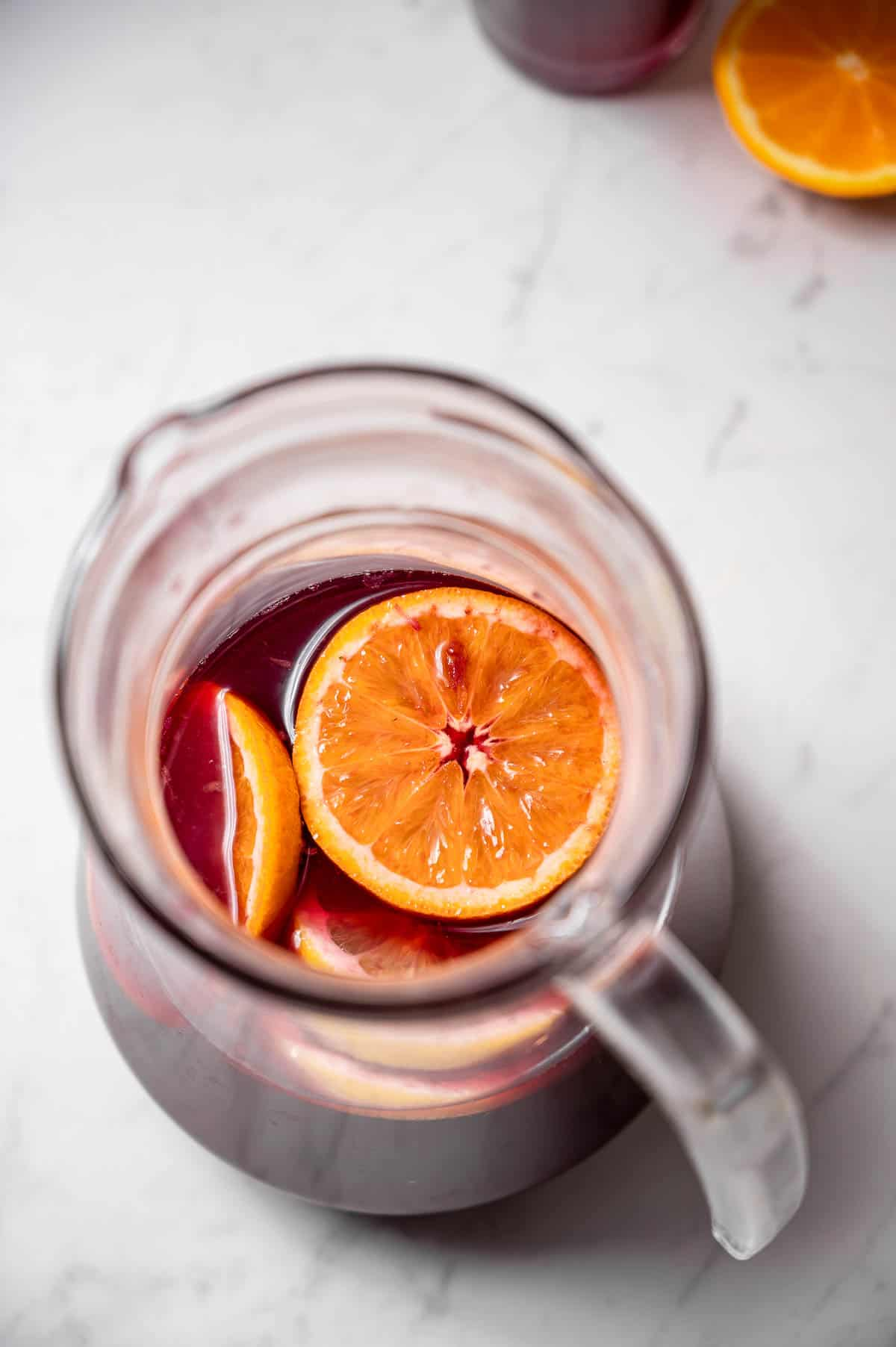 Overhead shot of a pitcher of tinto de verano with orange slices