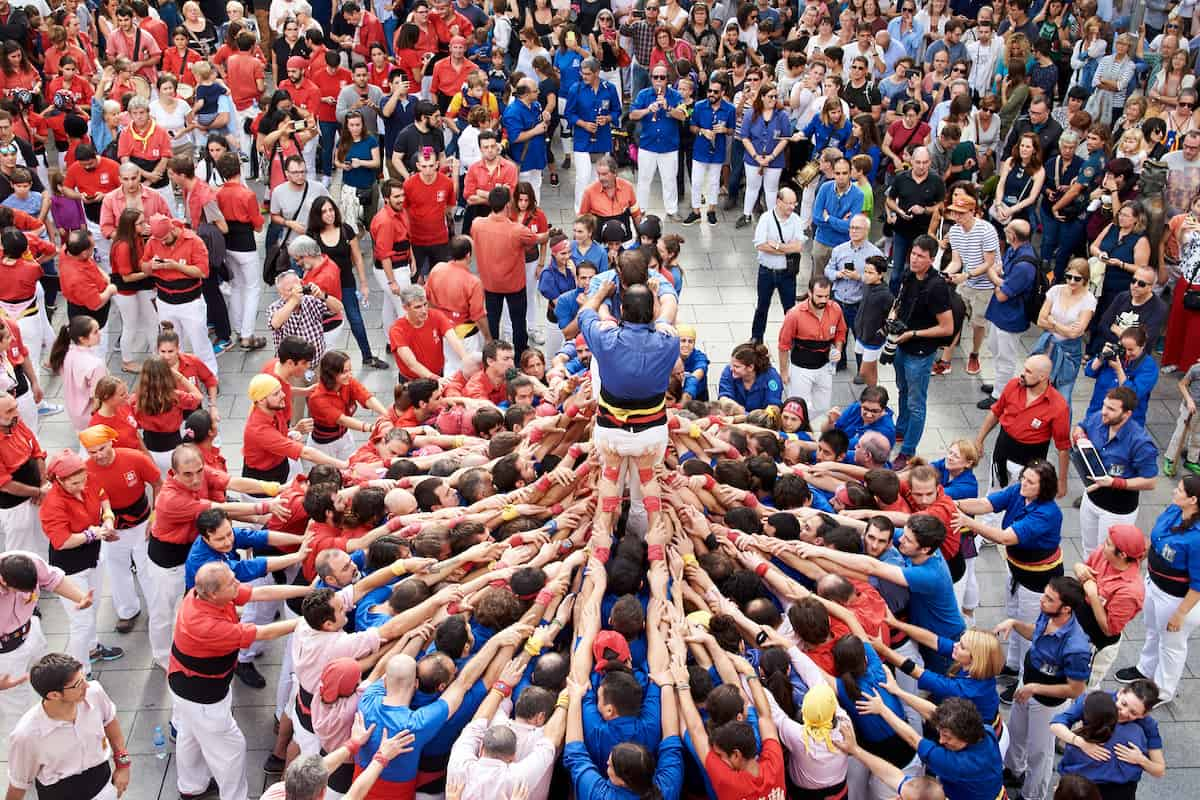 A group of castellers building a human tower in Barcelona